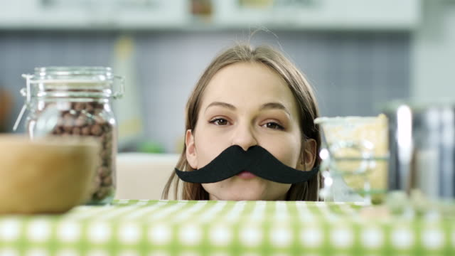 hipster girl with fake mustaches - comedian stock videos & royalty-free footage