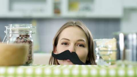 hipster girl with fake mustaches - moustache stock videos & royalty-free footage