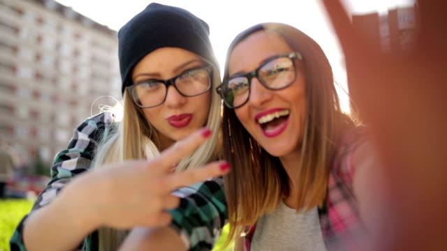 Hipster  girls making selfie