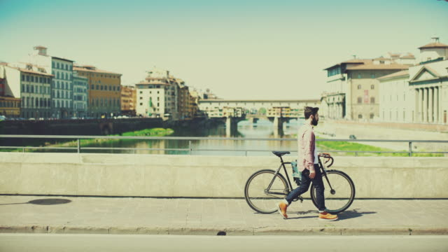 hipster guy with bicycle in florence, italy - florence italy stock videos & royalty-free footage