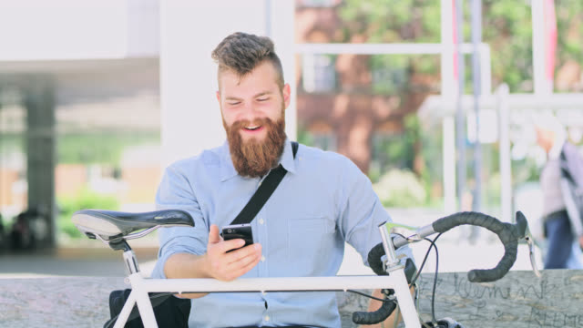 DS Hipster having a video call outdoor in the city
