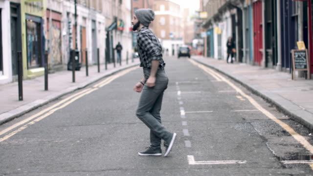 hipster male dancing in urban city street, looping video in 4k - full length stock videos & royalty-free footage