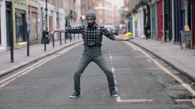 hipster male with beanie hat dancing in urban city street, with motion responds animation in 4k - attitude stock videos & royalty-free footage