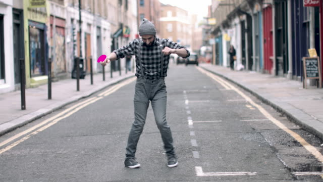 hipster male with beanie hat dancing in urban city street, with motion responds animation in 4k - full length stock videos & royalty-free footage