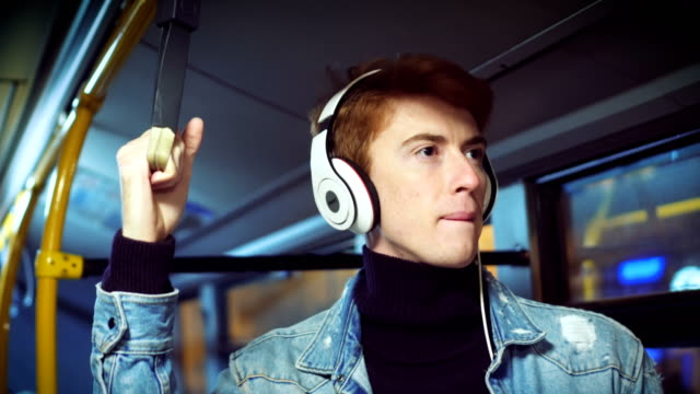 hipster man listening music in bus - vehicle interior stock videos and b-roll footage