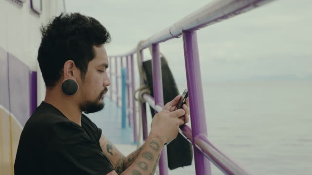 hipster man photographing the sea from the boat. - sailor stock videos & royalty-free footage