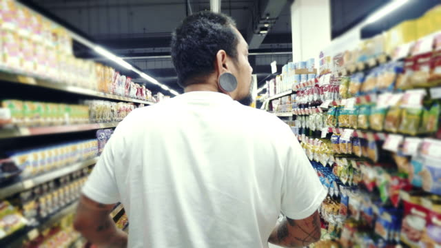 hipster man shopping in a supermarket - label stock videos & royalty-free footage