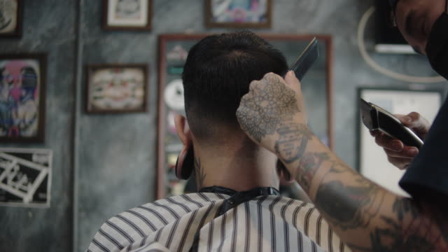 hipster men cutting hair to customer. - skill stock videos & royalty-free footage