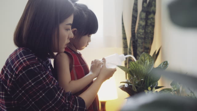hipster mother and daughter caring for plant - south east asia stock videos & royalty-free footage