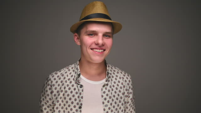 hipster man in hat - gray background stock videos and b-roll footage