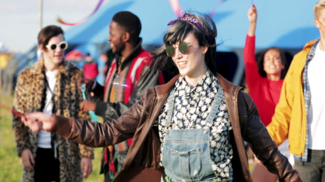 hipster person dancing at a festival - traditional festival stock videos & royalty-free footage
