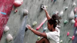 Hipster Person on Climbing Wall