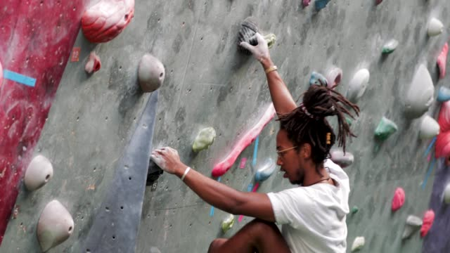 hipster person on climbing wall - surrounding wall stock videos & royalty-free footage