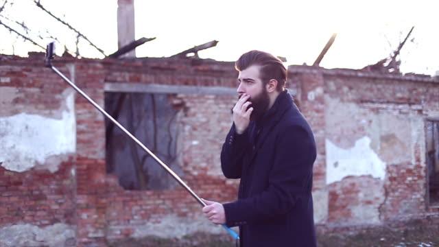 hipster style bearded man taking selfie with selfie stick - metrosexual stock videos & royalty-free footage