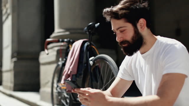 hipster stylish man with bicycle in florence, italy - motorcycle biker stock videos & royalty-free footage