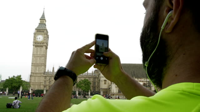CU Hipster Taking Picture Of Big Ben