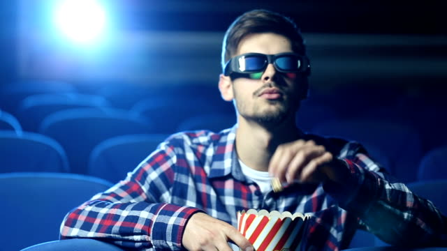 Hipster watching a movie
