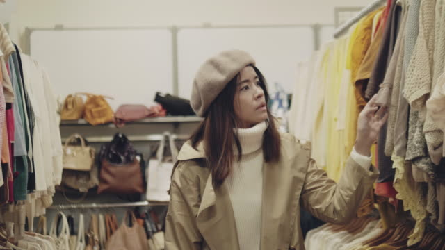 hipster woman buys a t-shirt in the store - choice stock videos & royalty-free footage