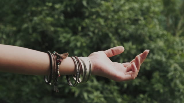 hipster woman hand wearing bangle is touching rain while traveling at the forest - bangle stock videos & royalty-free footage