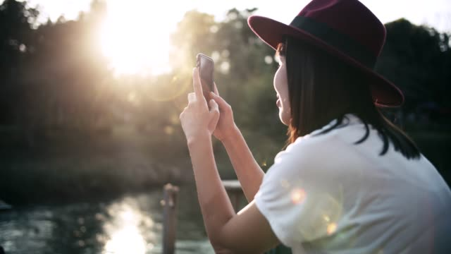 hipster woman using smart phone at dusk - portability stock videos & royalty-free footage