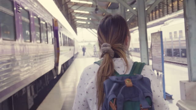 hipster women traveling by train - zaino da montagna video stock e b–roll