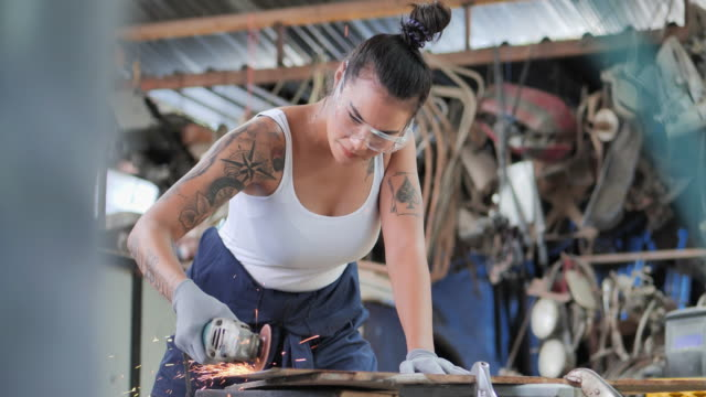 hipterof asian young women having tattooes on arms, she's welder using circular saw in workshop. - welding stock videos & royalty-free footage