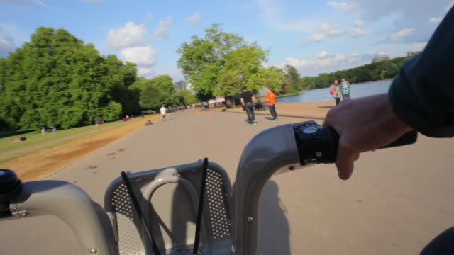 pov ws hire bike riding through hyde park london - hyde park london stock videos & royalty-free footage