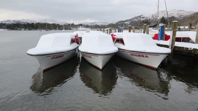 hire boats covered in snow on lake windermere, ambleside, lake district, uk. - recruit stock videos & royalty-free footage