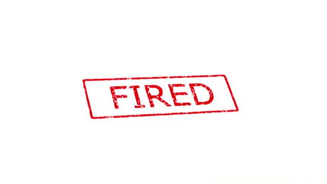stockvideo's en b-roll-footage met hired and fired stamp. - ontslaan