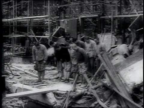 stockvideo's en b-roll-footage met hirohito walks though large manufacturing complex in yokohama with photographers around, leaves in motorcade after bowing; workers bowing to him /... - 1946