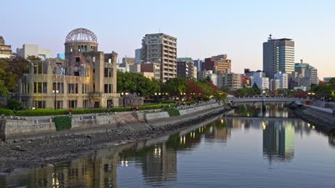 hiroshima atomic bomb dome cityscape al twilight japan 4k video - memorial video stock e b–roll