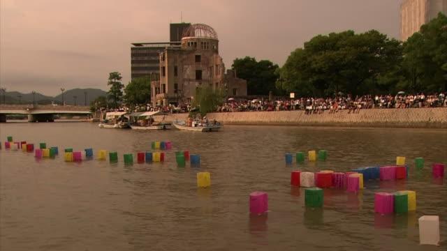 Hiroshima Day Lantern Ceremony at Motoyasuriver right next to Hiroshima Atomic Bomb Dome at sunset Long shot