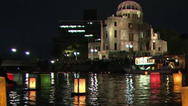 Hiroshima Day Lantern Ceremony at Motoyasuriver right next to Hiroshima Atomic Bomb Dome Lit up lanterns floating on the river night shot