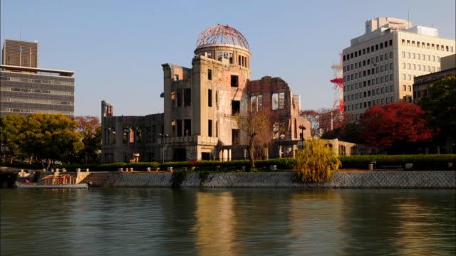 t/l ws hiroshima peace memorial across river, hiroshima, japan - hiroshima prefecture stock videos and b-roll footage
