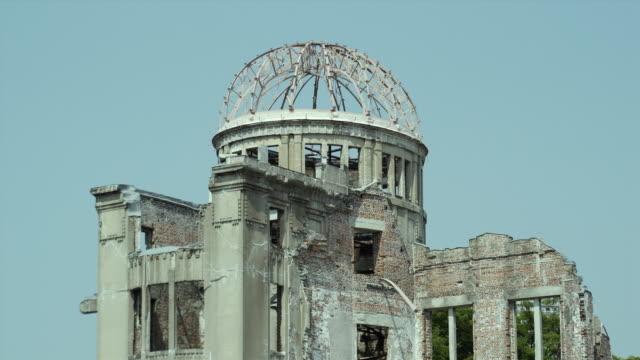 vidéos et rushes de ms hiroshima peace memorial (commonly called atomic bomb dome or a-bomb dome) against clear sky, hiroshima peace memorial park, hiroshima, japan - hiroshima prefecture