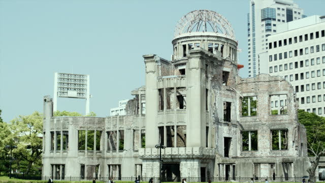 ws pan cu hiroshima peace memorial (commonly called atomic bomb dome or a-bomb dome) and old photograph of products exhibition hall before bombing, hiroshima peace memorial park, hiroshima, japan - nuclear weapon stock videos & royalty-free footage