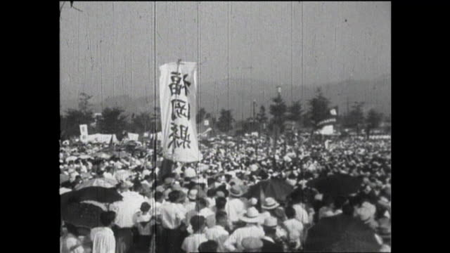 hiroshima peace memorial or atomic bomb dome; a crowd of people attending the hiroshima peace memorial ceremony on the 10th anniversary of a-bomb;... - nuclear weapon stock videos & royalty-free footage