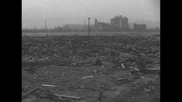hiroshima street with rubble on either side after atomic bomb blast during world war ii / man stands amid rubble / rubble lying about with puddle of... - rubble stock videos & royalty-free footage