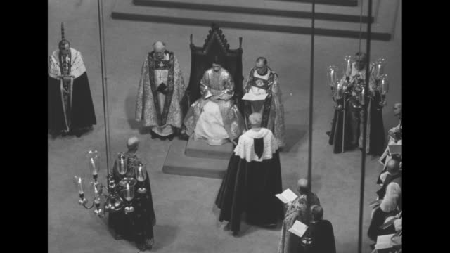 elizabeth sits in the coronation chair king edwardís chair under canopy held by knights of the garter flanked by church officials / she stands in... - princess margaret 1950 stock videos and b-roll footage