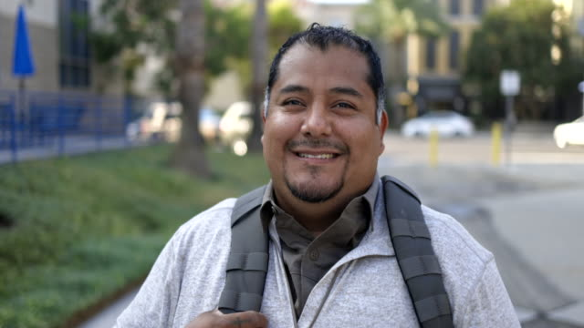 hispanic american veteran college student portrait - school supplies stock videos & royalty-free footage