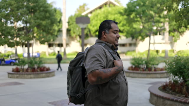 hispanic american veteran college student walking on campus - military uniform stock videos & royalty-free footage