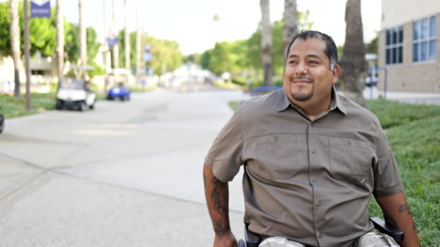 hispanic american veteran college student wearing mask in wheelchair - war veteran stock videos & royalty-free footage