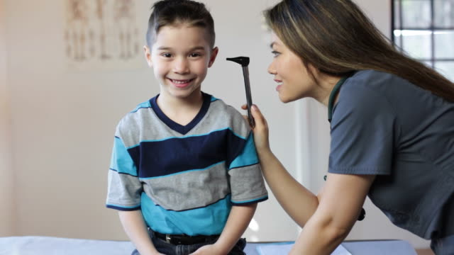 hispanic boy's pediatrician visit, ears - boy medical exam stock videos and b-roll footage