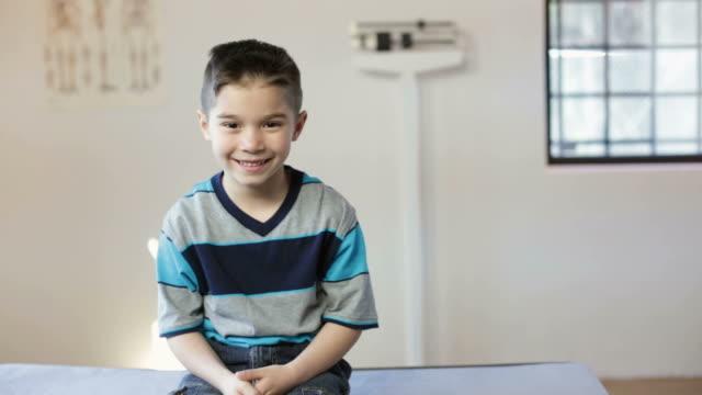 hispanic boy's pediatrician visit - boy medical exam stock videos and b-roll footage
