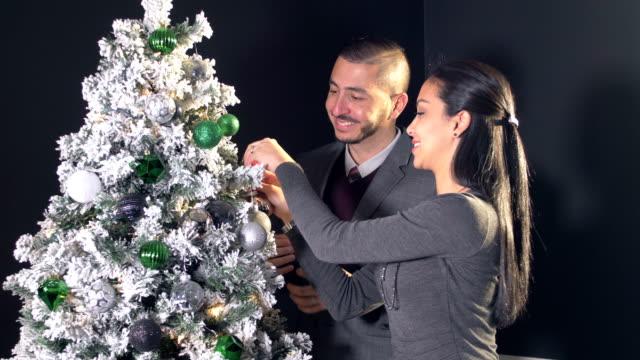 hispanic couple decorating christmas tree - shirt and tie stock videos & royalty-free footage