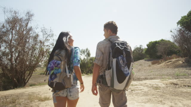 hispanic couple hiking outdoors together - southern california stock videos & royalty-free footage