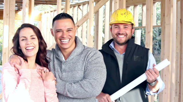 Hispanic couple with contractor, building new home