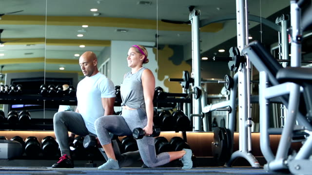 hispanic couple working out together, lunges - stepping stock videos & royalty-free footage