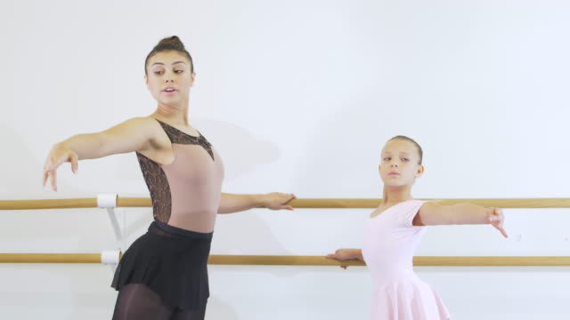 hispanic dance instructor with student in ballet class - 8 9 years stock videos & royalty-free footage