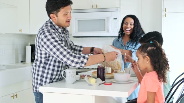 hispanic family eating breakfast in the kitchen - breakfast stock videos & royalty-free footage
